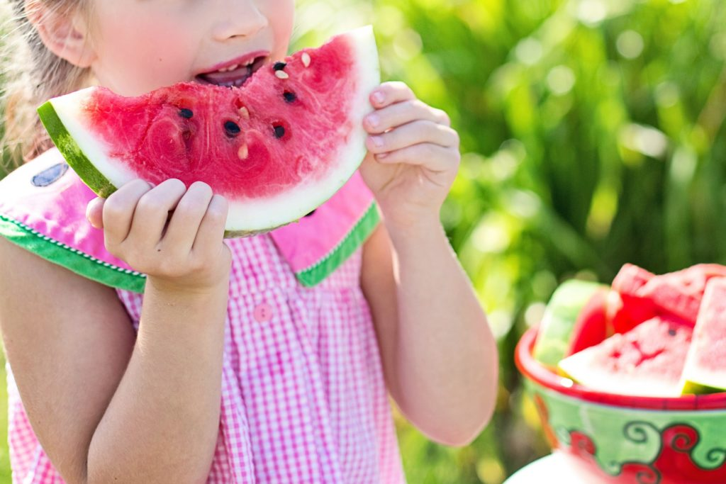 Young girl eating a water melon