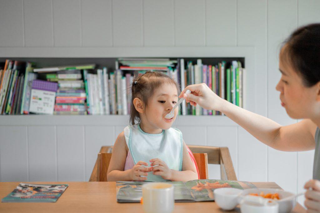 Toddler being feed